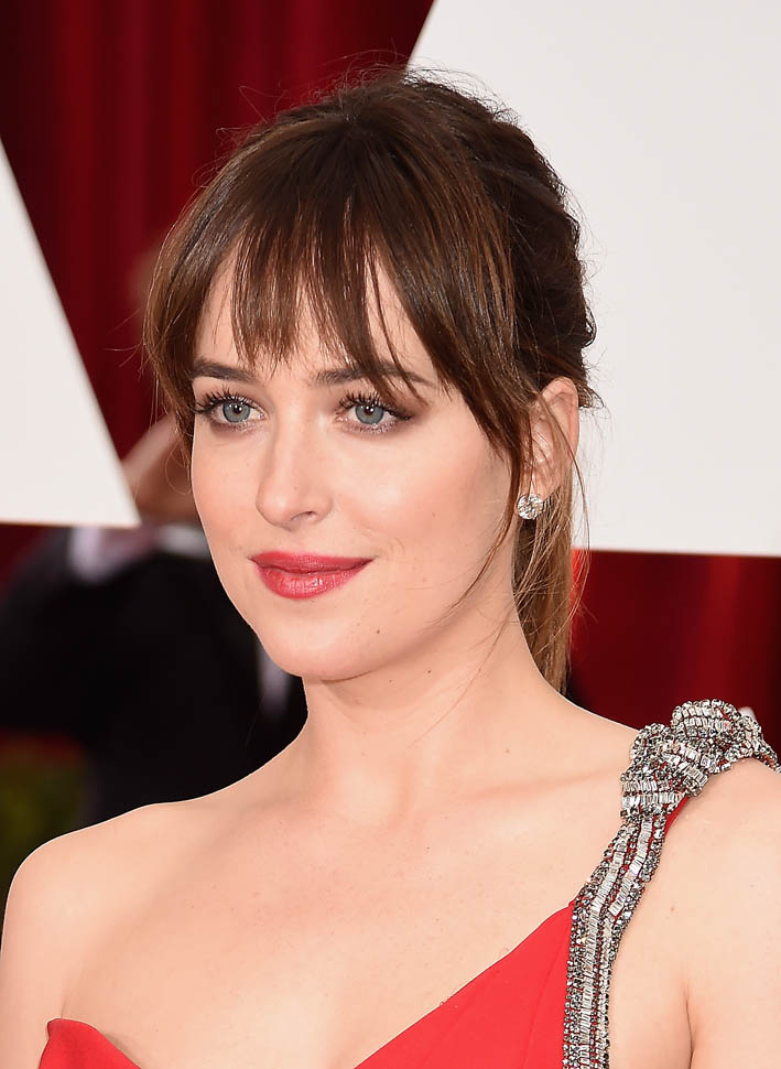 HOLLYWOOD, CA - FEBRUARY 22: Actress Dakota Johnson attends the 87th Annual Academy Awards at Hollywood & Highland Center on February 22, 2015 in Hollywood, California. (Photo by Jeff Kravitz/FilmMagic)